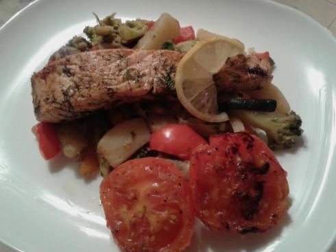 Dill stuffed salmon fillet served with veg and pan-fried tomatoes